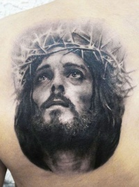 Awesome portrait of jesus in a crown of thorns tattoo