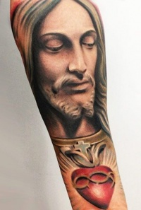 Colorful jesus and red heart forearm tattoo
