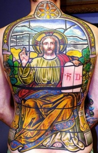 Coloured portrait preaching of jesus tattoo on whole back