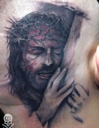 Detailed realistic portrait of jesus in a crown of thorns tattoo